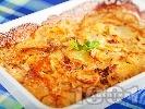 Рецепта Огретен от сурови картофи (без варене) с мариновани сушени домати, сметана и риган на фурна